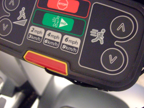 This touch-sensitive control panel on the treadmill allows users to adjust incline and speed, and also offers preset speed options.