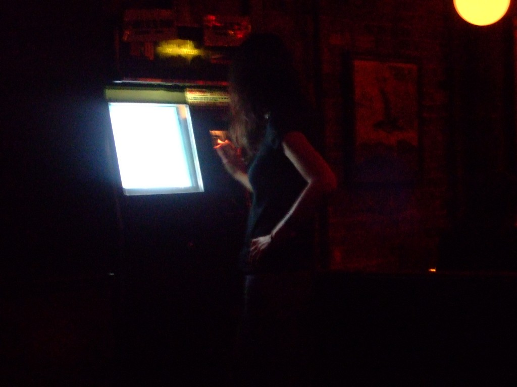 The bartender successfully completed her song choices on EL DJ. Familiarity helps.
